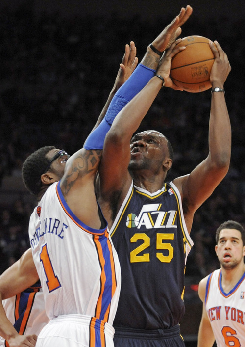 Utah Jazz center Al Jefferson, right, attempts to shoot as he is guarded by New York Knicks center Amare Stoudemire during the first quarter of an NBA basketball game Monday, March 7, 2011, at Madison Square Garden in New York. (AP Photo/Bill Kostroun)