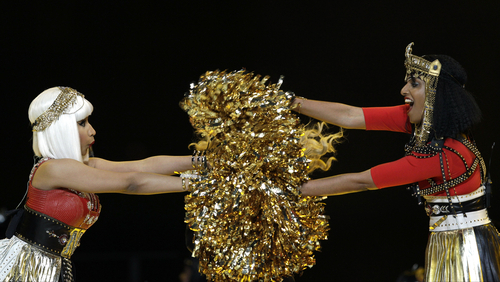 Nicki Minaj, left, and M.I.A. perform during halftime of the NFL Super Bowl XLVI football game between the New York Giants and the New England Patriots, Sunday, Feb. 5, 2012, in Indianapolis. (AP Photo/David J. Phillip)