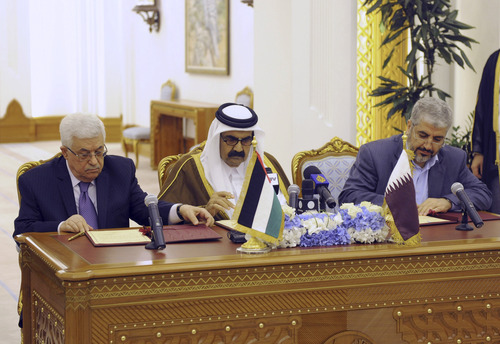 In this photo provided by the Palestinian Presiden's office, Palestinian President Mahmoud Abbas, left, and Khaled Mashal, chief of the Islamic militant group Hamas, right, sit with Qatar's crown prince Sheik Tamim Bin Hamad Al Thani as they sign a reconciliation agreement in Doha, Qatar, Monday, Feb. 6, 2012. The main Palestinian political rivals took a major step Monday toward healing their bitter rift, agreeing that Abbas would head an interim unity government to prepare for general elections in the West Bank and Gaza. (AP Photo/Thaer Ghanaim, Palestinian President's Office)