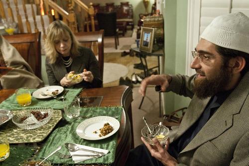 Chris Detrick  |  The Salt Lake Tribune Salt Lake Tribune reporter Peggy Fletcher Stack listens to Muhammed Mehtar speak as she breaks her Ramadan fast on Tuesday, Jan. 31, 2012.