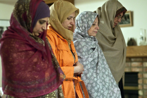 Chris Detrick  |  The Salt Lake Tribune Salt Lake Tribune reporter Peggy Fletcher Stack, second from right, participates in prayers with Noor ul-Hasan, Alia Rauf and Fahmida Ahmed Tuesday January 31, 2012.