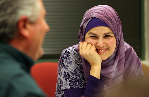 Steve Griffin  |  The Salt Lake Tribune   Members of the Muslim community gathered with Salt Lake Tribune employees to celebrate the end of Tribune religion writer, Peggy Fletcher Stack's 30-day Ramadan experience. The gathering took place in the Salt Lake Tribune offices in Salt Lake City, Utah  Wednesday, February 1, 2012. Here Maysa Kergaye talks with Tribune managing editor Terry Orme.