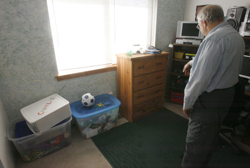 Rick Egan  | The Salt Lake Tribune   Chuck Cox, father of Susan Powell, looks through Charlie and Braden's toy box, in the room where they used to play, in his home in Puyallup, Washington, Saturday, February 6, 2012.