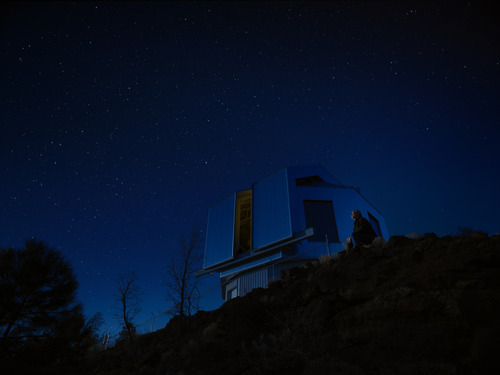 Don Kessler, retired Head of NASA's Orbital Debris, sits near an observatory on a starry night.  Courtesy Space Junk 3D, LLC