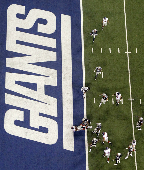 New York Giants running back Ahmad Bradshaw (44) rushes for a touchdown during the second half of the NFL Super Bowl XLVI football game against the New England Patriots, Sunday, Feb. 5, 2012, in Indianapolis. (AP Photo/David J. Phillip)