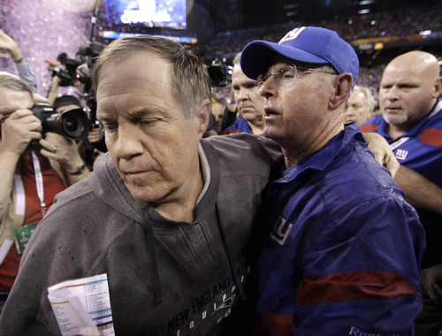 New England Patriots head coach Bill Belichick, left, turns away after greeting New York Giants head coach Tom Coughlin after the NFL Super Bowl XLVI football game, Sunday, Feb. 5, 2012, in Indianapolis. The Giants won 21-17. (AP Photo/David J. Phillip)