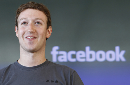 FILE - This Oct. 15, 2011 file photo, shows Facebook CEO Mark Zuckerberg smiling during a meeting in San Francisco. Will Facebook list its stock on the New York Stock Exchange or the Nasdaq? It comes down to