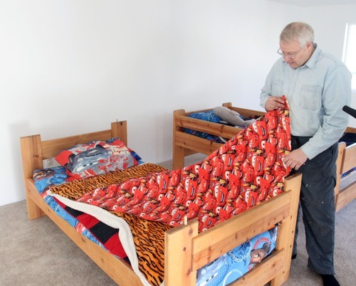 Rick Egan  | The Salt Lake Tribune   Chuck Cox, father of Susan Powell, shows the quilt from the movie
