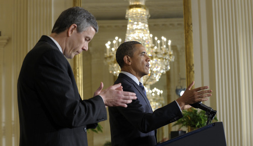 Susan Walsh  |  The Associated Press President Barack Obama, accompanied by Education Secretary Arne Duncan, speaks about flexibility for states in the No Child Left Behind law, Thursday, Feb. 9, 2012, in the East Room of the White House in Washington.