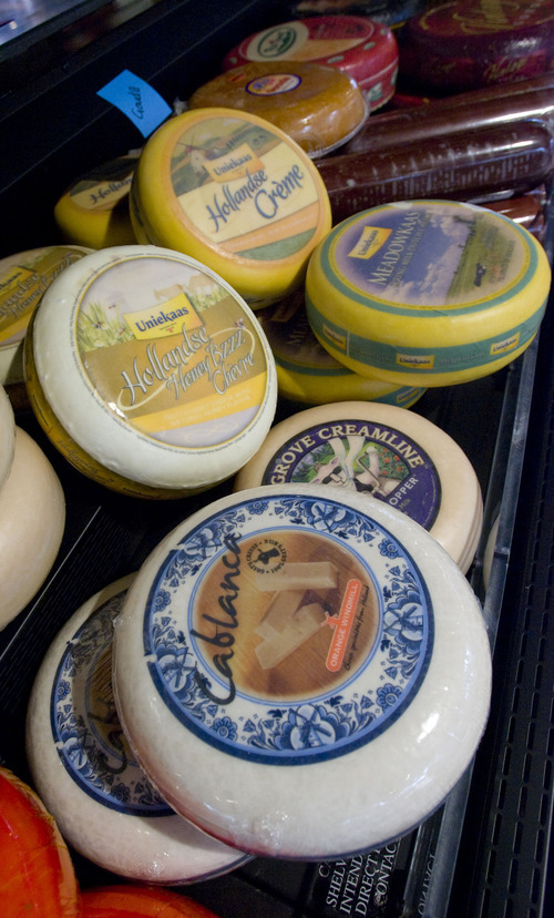 Al Hartmann  |  The Salt Lake Tribune Wheels of artisan cheeses line the deli counter at the Harmons City Creek store, whose frozen food aisles will feature lights that dim when there are no shoppers in the vicinity, and  brighten when someone walks by.