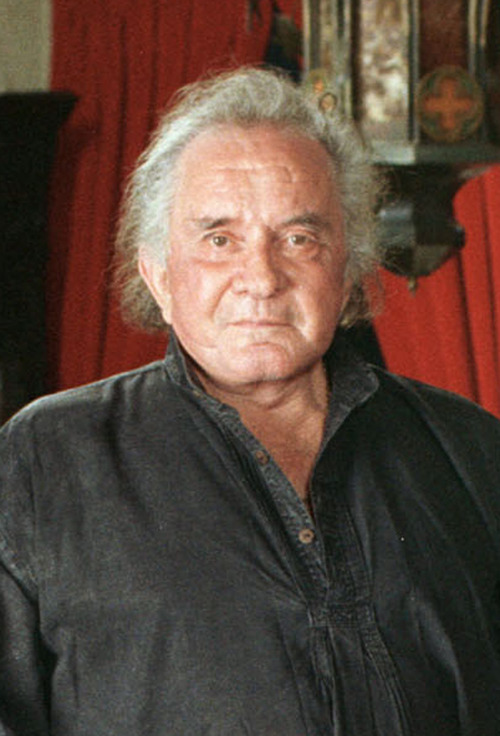 FILE - In a 1999 file photo, the late country music legend Johnny Cash is shown at his Hendersonville, Tenn. home. Cash would have turned 80 on Feb. 26. His family will attend the groundbreaking at the Johnny Cash Boyhood Home Project in Dyess, Ark., a museum will open in Nashville later this year and three documentaries are in the works. (AP Photo/Mark Humphrey, file)