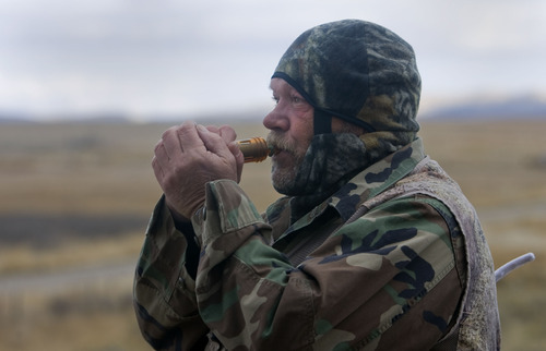 Al Hartmann  |  The Salt Lake Tribune Bill Keebler is a guide and outfitter who specializes in coyote hunting. He uses reed callers to lure the coyotes to him. He can make over 100 distinct calls that communicate to the animals.