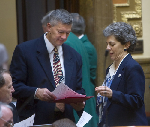 Al Hartmann  |  Tribune file photo Rebublican Rep. Wayne Haprer, R-West Jordan, left, confers with Rep. Patrice Arent, D-Millcreek. Harper's bill to scrap Salt Lake City's anti-idling ordinance cleared a committee on Thursday.