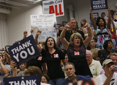 Opponents of the health care reform bill shout at former Vermont Gov. Howard Dean at a town hall style meeting on health care reform with Dean and Rep. Jim Moran, D-Va., at South Lakes High School in Reston, Va., Tuesday, Aug. 25, 2009.(AP Photo/Charles Dharapak)