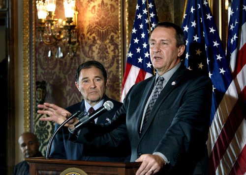 Scott Sommerdorf     The Salt Lake Tribune              Utah Gov. Gary R. Herbert, left, listens as Attorney General Mark Shurtleff talks about the estimated $171 million settlement due the state as part of a $25 billion settlement over abusive foreclosure practices from five major banks during a press conference at the Capitol Thursday.
