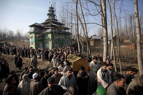 Kashmiri villagers carry the coffin of Gul Mohammad Dar, a pro-India party worker and a rural body head, during his funeral procession in Hawoormisshipora village, some 65 Kilometers (40 miles) south of Srinagar, India, Friday, Feb. 10, 2012. Police in Indian Kashmir say unidentified gunmen shot dead a political worker and a rural body head of pro-Indian party and wounded another late Thursday night. At least 698 politicians including leaders and workers were killed in Indian-controlled Kashmir since 1990, according to a 2011 government statistic. (AP Photo/Dar Yasin)