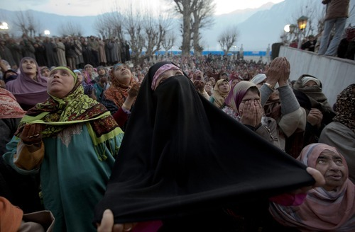 A veiled Kashmiri Muslim woman prays as the head priest, unseen, displays a relic of Islam's Prophet Muhammad at the Hazratbal shrine on the Friday following Eid Milad-un Nabi, marking the birth anniversary of Prophet Mohammad, in Srinagar, India, Friday, Feb. 10, 2012. Thousands of Kashmiri Muslims gathered at the Hazratbal shrine, which houses a relic believed to be a hair from the beard of the Prophet. (AP Photo/Dar Yasin)
