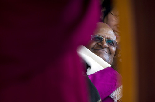 Archbishop Desmond Tutu, who was awarded the Nobel Peace Prize for his part in fighting apartheid, listens to a speech by the Dalai Lama during a felicitation event for him in Dharmsala, India, Friday, Feb. 10, 2012. Hundreds of exiles cheered as the Dalai Lama and the Tibetan government-in-exile felicitated the Archbishop at the Tsuglakhang temple. Tutu is in the country to support the