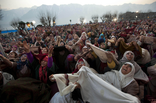 Kashmiri Muslim women pray as the head priest, unseen, displays a relic of Islam's Prophet Muhammad at the Hazratbal shrine on the Friday following Eid Milad-un Nabi, marking the birth anniversary of Prophet Mohammad, in Srinagar, India, Friday, Feb. 10, 2012. Thousands of Kashmiri Muslims gathered at the Hazratbal shrine, which houses a relic believed to be a hair from the beard of the Prophet. (AP Photo/Dar Yasin)