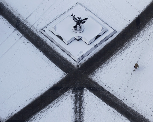 A woman walks across a snow covered square in Ostrava, Czech Republic, on Friday Feb. 10,2012. Europe has been battling a deep freeze that started in late January.  (AP Photo/Petr David Josek)