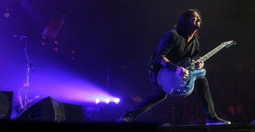 Steve Griffin  |  The Salt Lake Tribune   Foo Fighters lead singer Dave Grohl rips it up on his guitar during their concert at the Maverik Center in West Valley City on Tuesday, Oct. 11, 2011.
