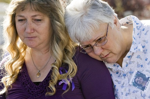 Djamila Grossman  |  Tribune file photo Debbie Caldwell, left, and Michele Oreno, friends of Susan Cox Powell, get emotional during a ceremony and balloon release to mark Powell's birthday at West View Park in West Valley City on Oct., 16, 2010.