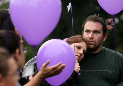 Janet Jensen  |  AP file phto Susan Powell's sister Denise Cox leans on her fiance, Andrew Olsen, during a gathering of friends and family of Powell's to honor the missing woman and celebrate her 30th birthday at Bradley Park in Puyallup, Wash., Oct. 16, 2011. Cox shared childhood memories of her sister, and those gathered released dozens of purple balloons.