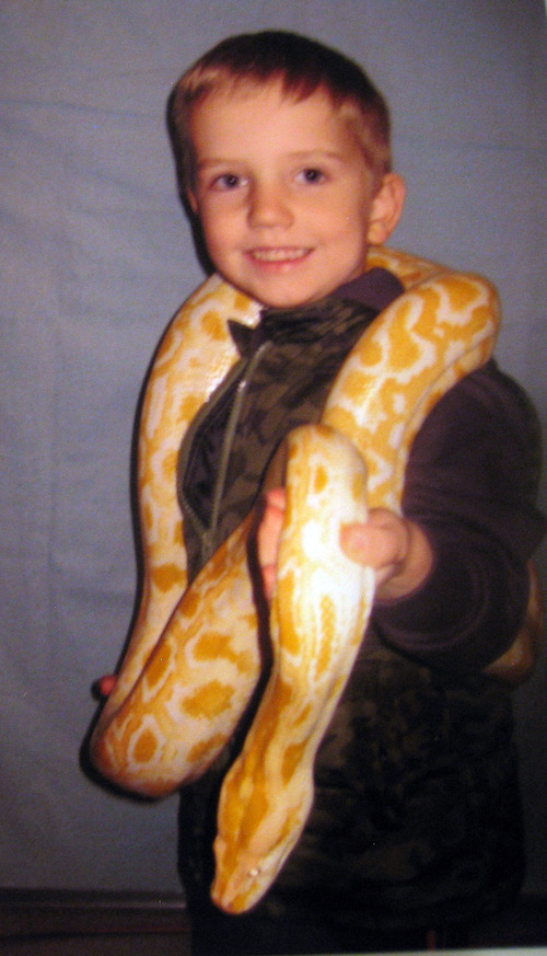 Braden Powell holds a snake in this  family photo from last October. Photo courtesy of the Cox family