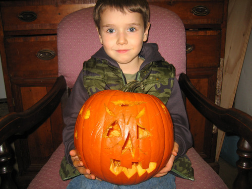 Charlie Powell holds a pumpkin  in Puyallup, Wash., in a family photo from last Halloween. Photo courtesy of the Cox family