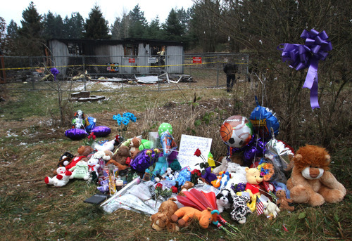 Rick Egan  | The Salt Lake Tribune   Stuffed animals, balloons, and children's toys such as Pokémon cards make up a memorial near the home where Josh Powell took his life and the lives of Charlie and Braden, in Graham, Washington, Wednesday, February 8, 2012.