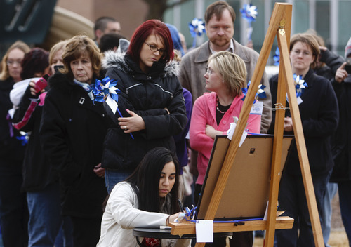 Trent Nelson  |  The Salt Lake Tribune People wait in line to write in a book at a community pinwheel vigil for Charlie and Braden Powell in the Municipal Gardens Playground Thursday in Ogden. The event was put on by Prevent Child Abuse Utah.