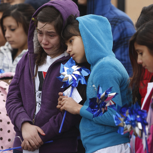 Trent Nelson  |  The Salt Lake Tribune Raquel Trujillo, left, is comforted by Saray Becerra at a community pinwheel vigil for Charlie and Braden Powell in the Municipal Gardens Playground Thursday in Ogden. The event was put on by Prevent Child Abuse Utah.