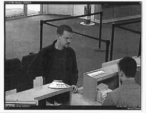 Surveillance image of Josh Powell withdrawing $7,000 from a bank the day before setting fire to his home and killing himself and his sons.
