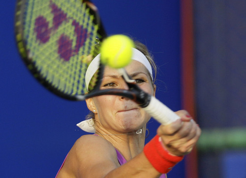 Maria Kirilenko of Russia returns a shot against Sorana Cirstea of Romania during their semifinal tennis match at the Pattaya Open in Pattaya, Thailand, Saturday, Feb. 11, 2012. (AP Photo/Sakchai Lalit)