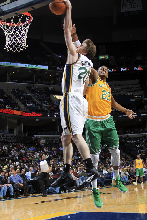 Utah Jazz forward Gordon Hayward (20) shoots past Memphis Grizzlies forward Rudy Gay (22) in the first half of an NBA basketball game on Sunday, Feb. 12, 2012, in Memphis, Tenn. (AP Photo/Nikki Boertman)