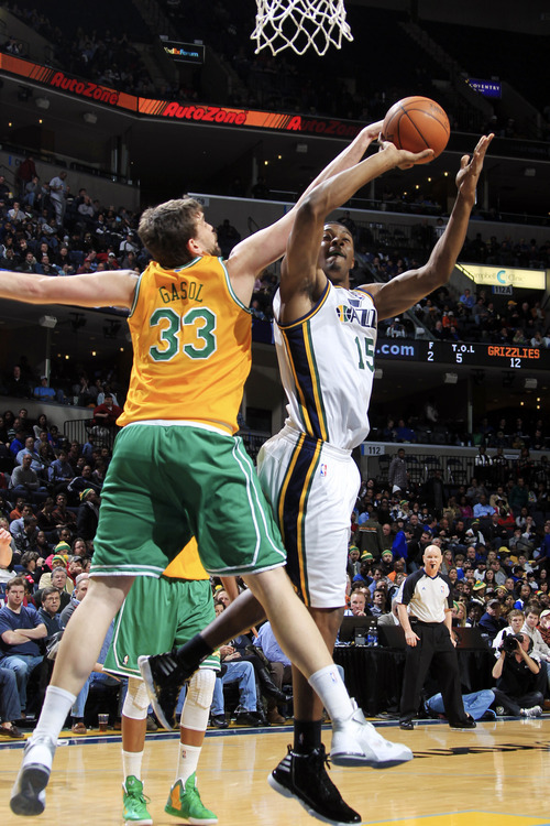 Utah Jazz forward Derrick Favors (15) shoots while Memphis Grizzlies center Marc Gasol (33), of Spain, defends in the first half of an NBA basketball game on Sunday, Feb. 12, 2012, in Memphis, Tenn. (AP Photo/Nikki Boertman)