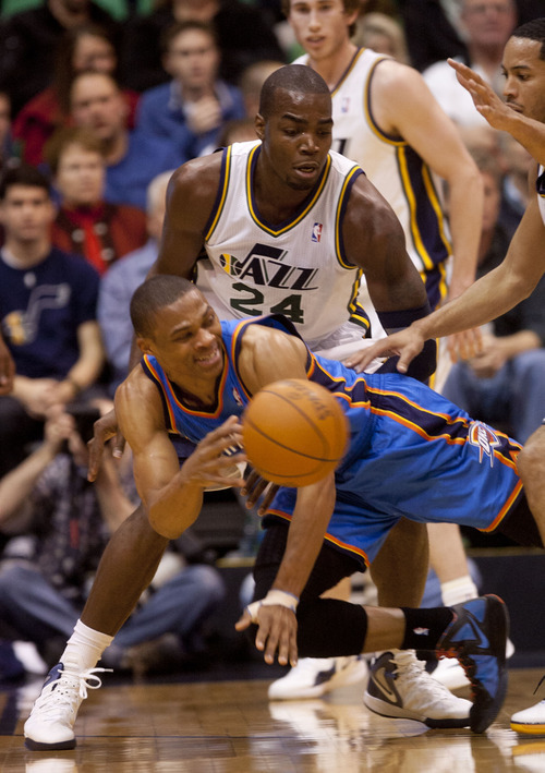 Trent Nelson  |  The Salt Lake Tribune Oklahoma City Thunder guard Russell Westbrook (0) passes the ball out of the double team by Utah Jazz forward Paul Millsap (24) and guard Devin Harris (5) as the Utah Jazz host the Oklahoma City Thunder, NBA basketball at EnergySolutions Arena Friday, February 10, 2012 in Salt Lake City, Utah.