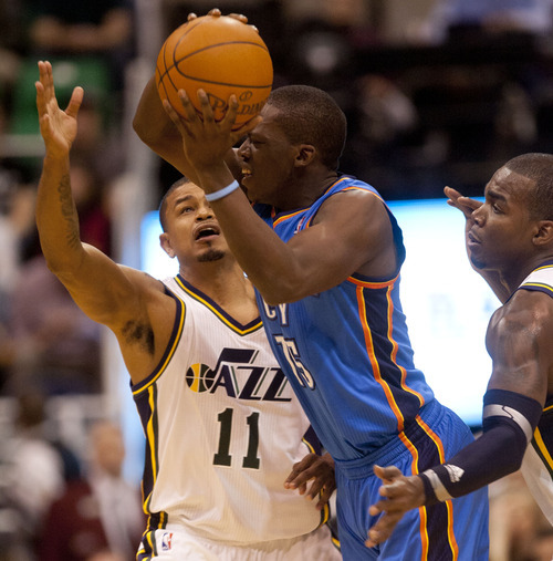 Trent Nelson  |  The Salt Lake Tribune Oklahoma City Thunder's Reggie Jackson (15) passes the ball out of the double team by Utah Jazz guard Earl Watson (11) and forward Paul Millsap (24) as the Utah Jazz host the Oklahoma City Thunder, NBA basketball at EnergySolutions Arena Friday, February 10, 2012 in Salt Lake City, Utah.