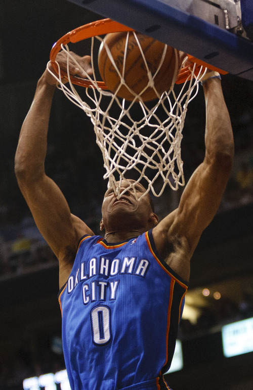 Trent Nelson  |  The Salt Lake Tribune Oklahoma City Thunder guard Russell Westbrook (0) dunks the ball as the Utah Jazz host the Oklahoma City Thunder, NBA basketball at EnergySolutions Arena Saturday, February 11, 2012 in Salt Lake City, Utah.