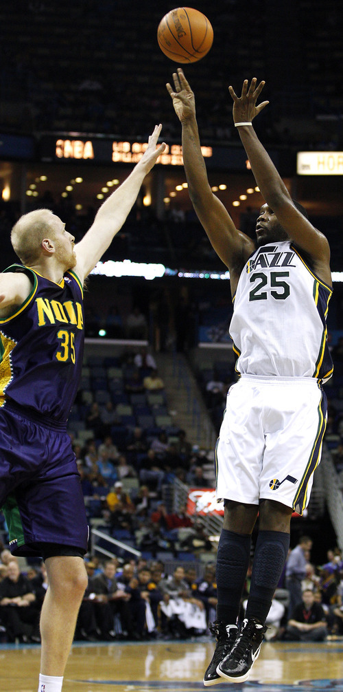 Utah Jazz center Al Jefferson (25) shoots the ball over New Orleans Hornets center Chris Kaman (35) in the first half of an NBA basketball game in New Orleans, Monday, Feb. 13, 2012. (AP Photo/Jonathan Bachman)