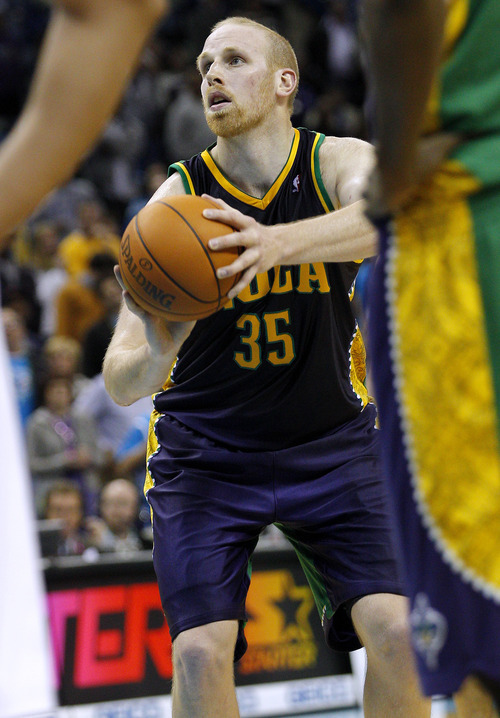 New Orleans Hornets center Chris Kaman (35) shoots a foul shot in the second half of an NBA basketball game in New Orleans, Monday, Feb. 13, 2012. The Hornets won their fifth game this season 86-80. Chris Kaman led the Hornets with 27 points. (AP Photo/Jonathan Bachman)