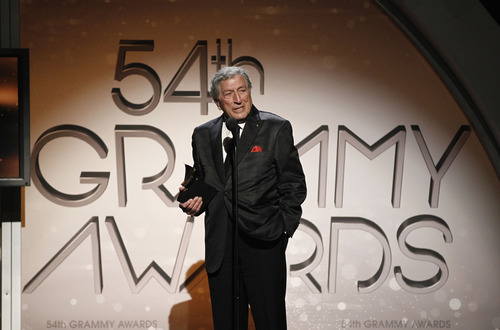 Tony Bennett accept the award for traditional pop vocal album at the 54th annual GRAMMY Awards pre-show on Sunday, Feb. 12, 2012 in Los Angeles. (AP Photo/Matt Sayles)