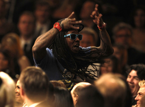 Lil Wayne watches Nicki Minaj perform during the 54th annual Grammy Awards on Sunday, Feb. 12, 2012 in Los Angeles. (AP Photo/Matt Sayles)