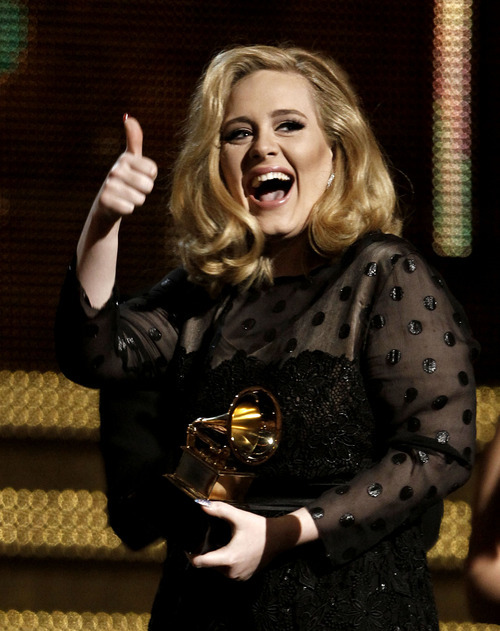 Adele accepts the award for record of the year for