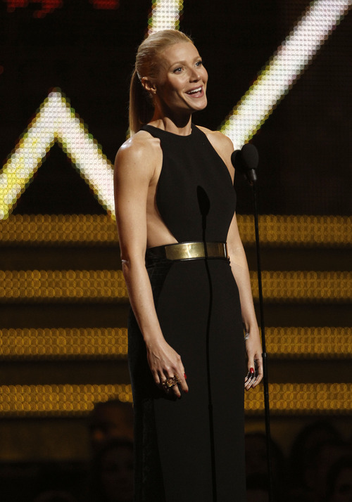 Gwyneth Paltrow introduces Adele onstage during the 54th annual Grammy Awards on Sunday, Feb. 12, 2012 in Los Angeles. (AP Photo/Matt Sayles)