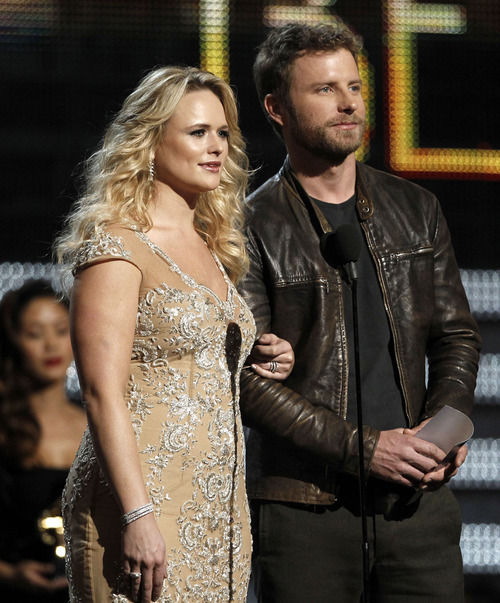 Miranda Lambert, left, and Dierks Bentley present an award onstage during the 54th annual Grammy Awards on Sunday, Feb. 12, 2012 in Los Angeles. (AP Photo/Matt Sayles)