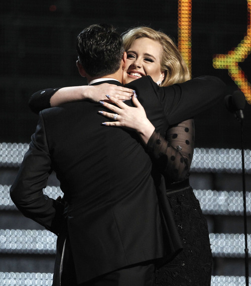 Adele, right, and Paul Epworth accept the award for song of the year for