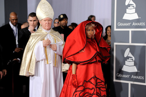 Nicki Minaj, right,  arrives at the 54th annual Grammy Awards on Sunday, Feb. 12, 2012 in Los Angeles. (AP Photo/Chris Pizzello)