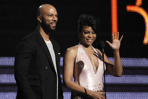 Taraji P. Henson, right, and Common present the award for best R&B album during the 54th annual Grammy Awards on Sunday, Feb. 12, 2012 in Los Angeles. (AP Photo/Matt Sayles)