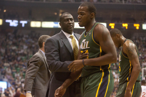 Jeremy Harmon  |  The Salt Lake Tribune  Utah coach Tyrone Corbin talks to Paul Millsap as he leaves the court as the Jazz face the 76ers at EnergySolutions Arena on Friday, December 30, 2011.